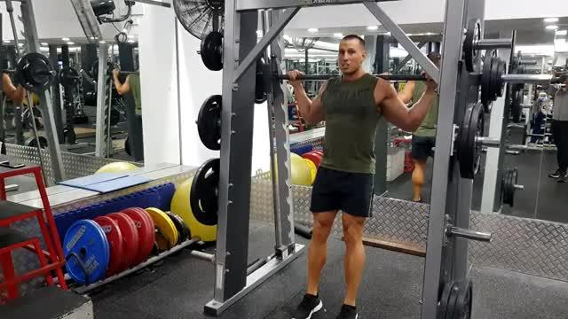 Male Feet Forward Smith Machine Squat demonstration