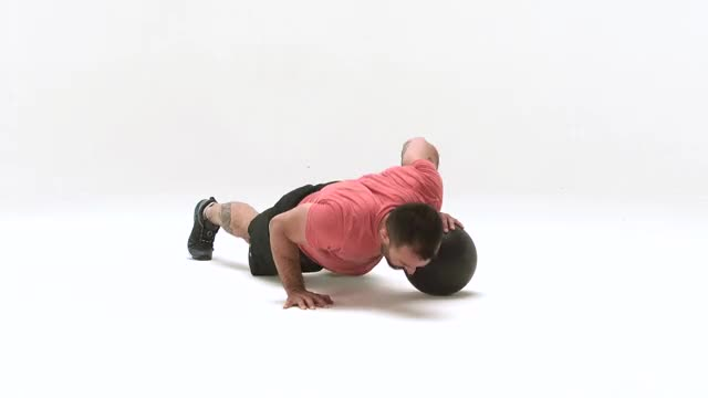 Pushup with One Hand on Medicine Ball demonstration
