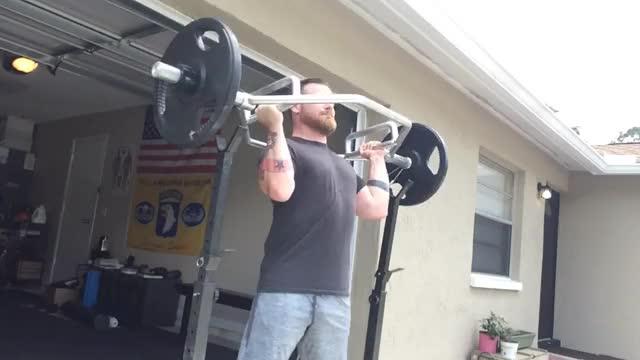 Male Standing Trap Bar Shoulder Press demonstration