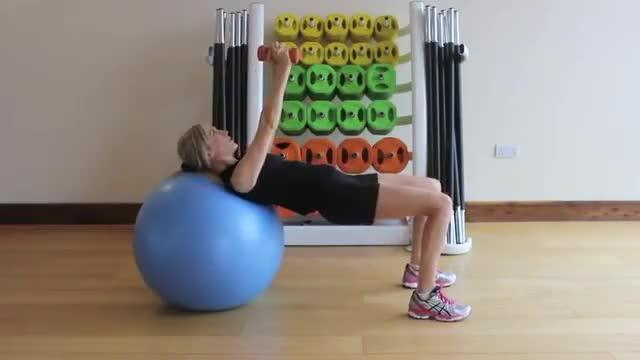 Female Dumbbell Russian Twist (on stability ball) demonstration