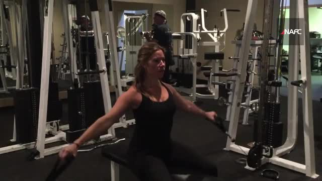 Female Cable Seated Front Lateral Raise demonstration