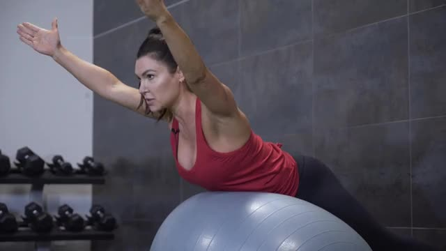 Female Back Extension (on stability ball, arms up) demonstration