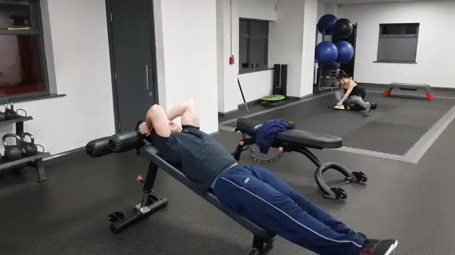 Male Decline Bench Leg Raise demonstration