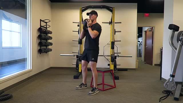 Male Dumbbell Goblet Box Squat demonstration