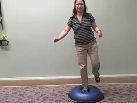 Female BOSU Ball Single-Leg Balance demonstration