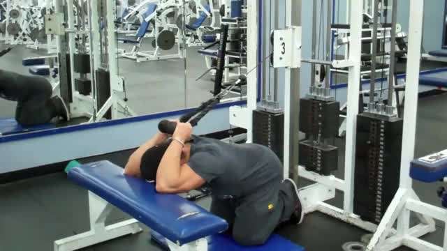Male Kneeling Overhead Tricep Extension Over Flat Bench demonstration