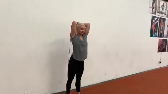 Female Overhead Banded Tricep Extension demonstration