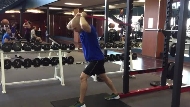 Male Overhead Banded Tricep Extension demonstration