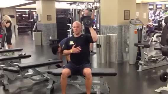 Male One Arm Seated Palms In Dumbbell Press demonstration