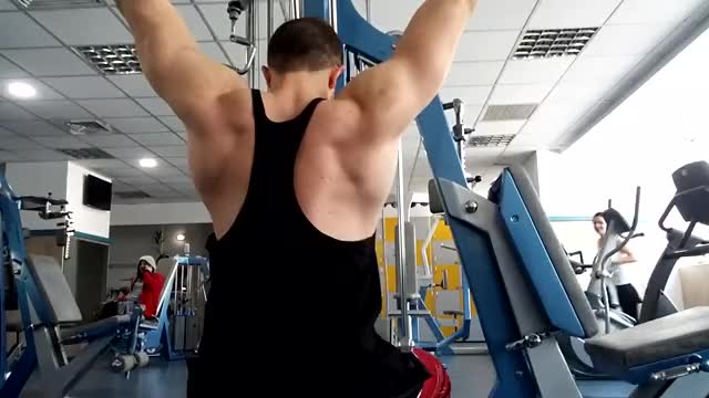 Wide-Grip Pulldown Behind The Neck demonstration