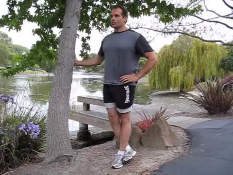 Self-assisted Single Leg Squat (leg wrapped) demonstration