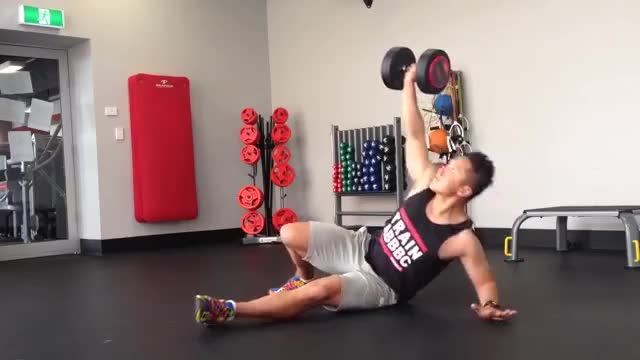 Male Dumbbell Turkish Getup demonstration