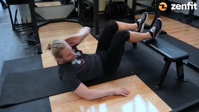 Oblique Crunches (Feet on Bench) demonstration