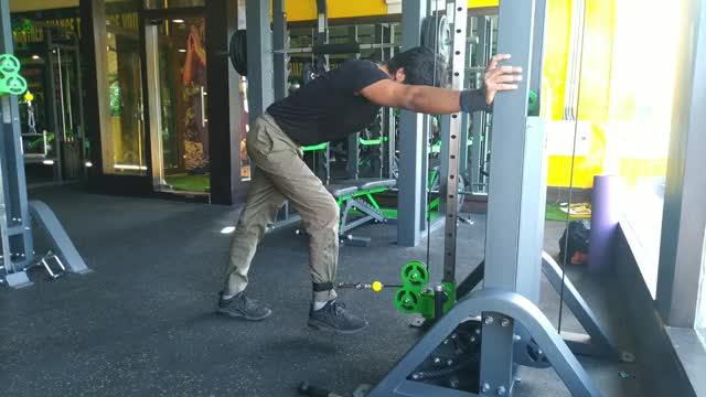 Male Cable Bent-over Leg Curl demonstration