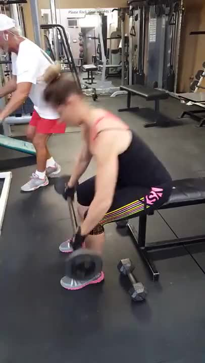 Female Seated High Barbell Front Raise demonstration