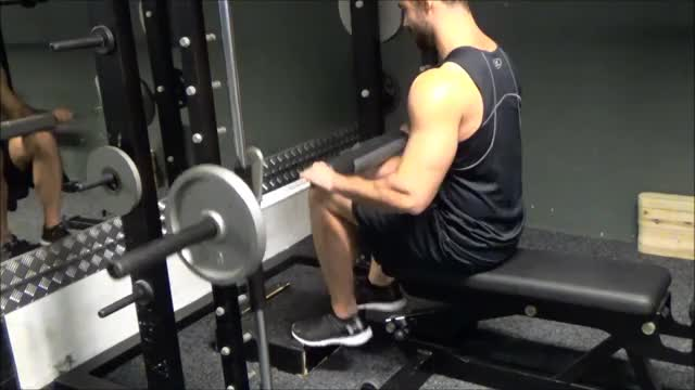 Male Smith Seated Calf Raise demonstration