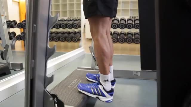 Male Smith Standing Leg Calf Raise demonstration
