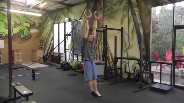 Male Suspended Muscle-up (with kip) demonstration