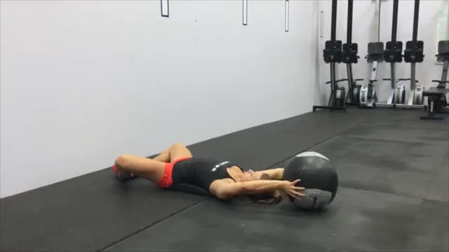 Female Wall Ball Sit Up demonstration