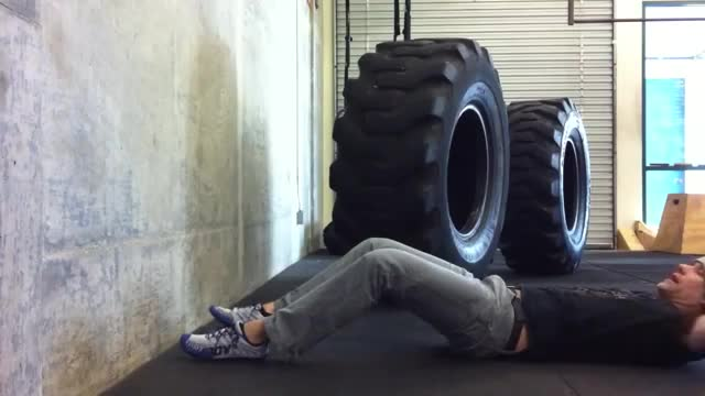 Male Wall Ball Sit Up demonstration