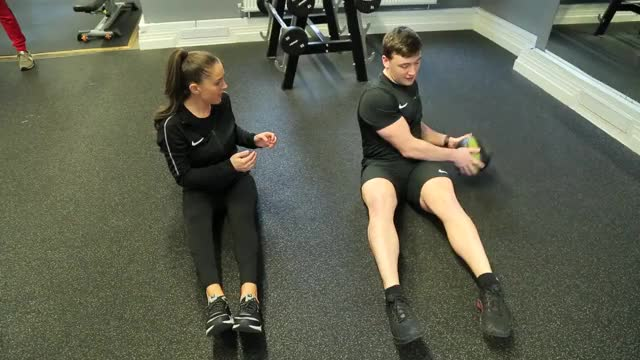 Medicine Ball Seated Backward Twist Throw (with partner standing) demonstration