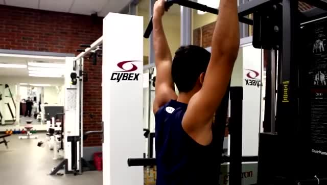 Machine-assisted Pull-up (open-centered bar, standing) demonstration