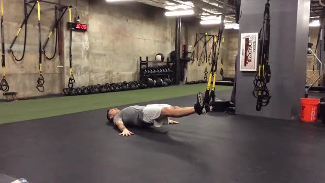 TRX Hamstring Curl to Hip Press demonstration