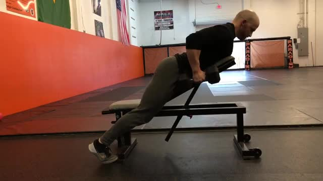 Male Chest Supported Dumbbell Row with Isohold demonstration
