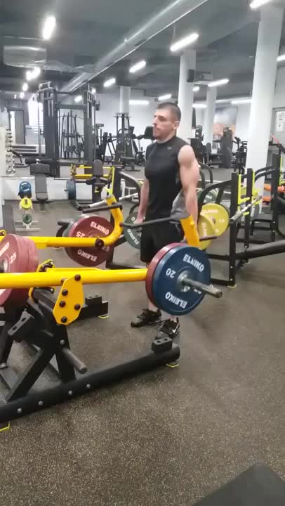 Lever Barbell Shrug (plate loaded) demonstration