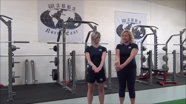 Female Standing Behind-the-Back Bicep Stretch demonstration