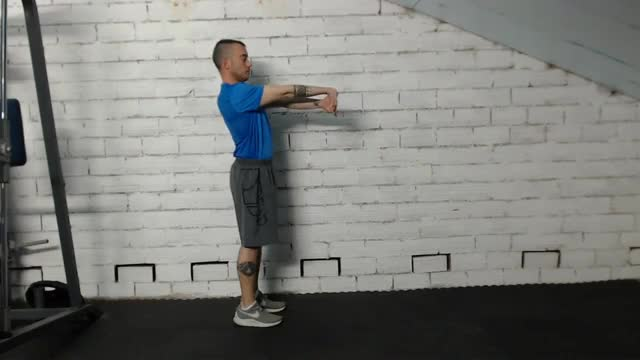 Standing Behind-the-Back Bicep Stretch demonstration