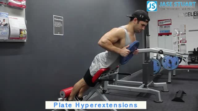 Weighted 45° Back Extension (on hyperextension apparatus) demonstration