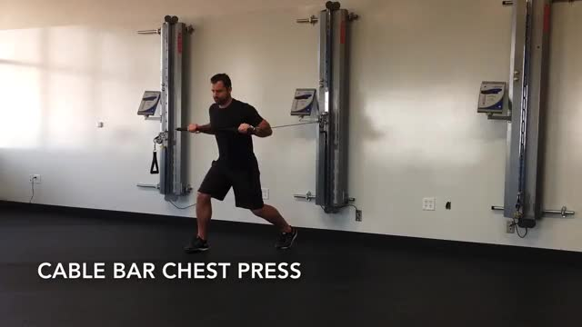 Male Cable Bar Standing Chest Press demonstration