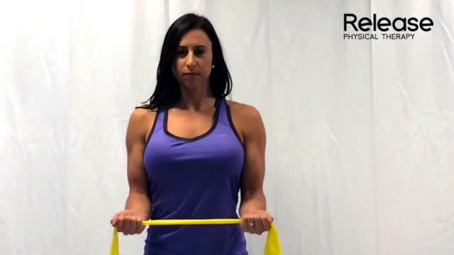 Female Standing External Rotation with Resistance Band (No Money Drill) demonstration
