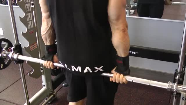 Male Standing Smith Machine Wrist Curl (behind back) demonstration