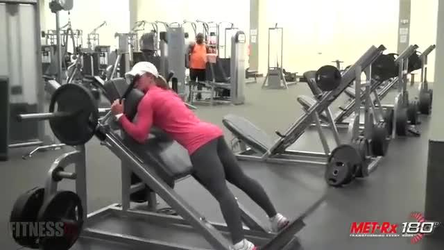 Female Reverse hack Squat demonstration