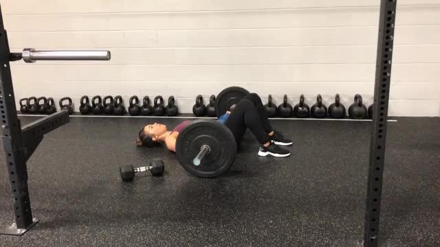 Female Barbell Hip Thrust on Floor demonstration