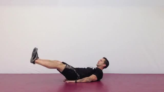 Male Lying Knee Raise (on floor) demonstration