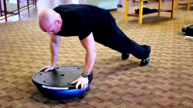 Male BOSU Burpee demonstration