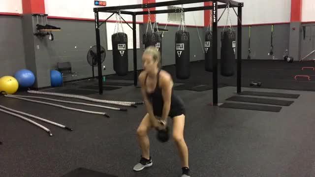 Female Kettlebell Two Arm Overhead Swing demonstration
