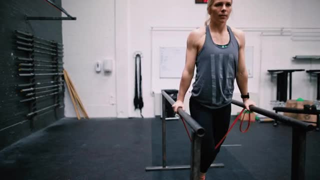Female Band-assisted Chest Dip demonstration