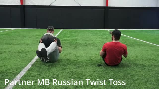 Medicine Ball Russian Twist Throw (with partner) demonstration