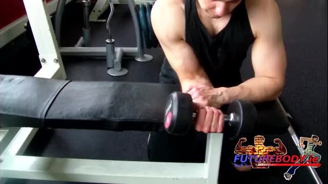 Male One Arm Dumbbell Wrist Curl Over Bench demonstration