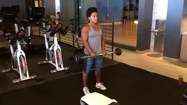 Female EZ Bar Reverse Grip Barbell Curl demonstration