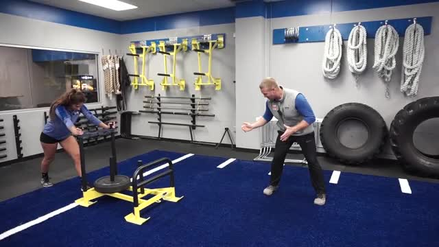 Female Weighted Drive Sled Sprint demonstration