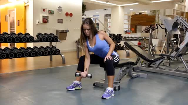 Female One Arm Seated Dumbbell Curl demonstration