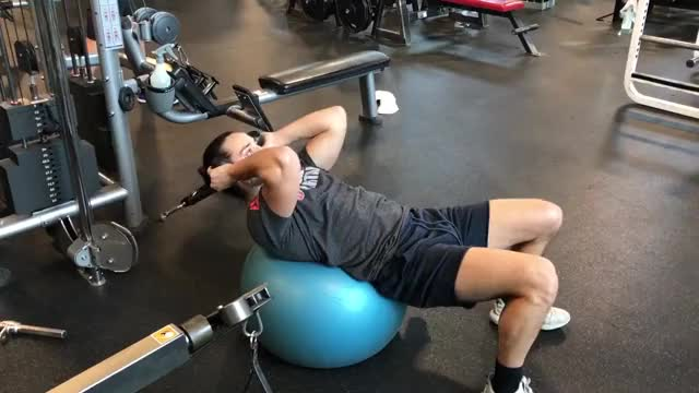 Male Cable Lying Crunch (on stability ball) demonstration