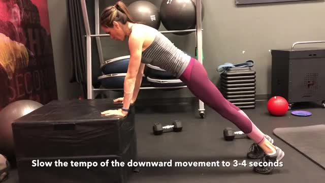 Female Eccentric Only Incline Push Up demonstration