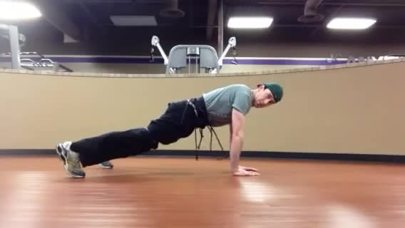 Plank with Arm Raise demonstration