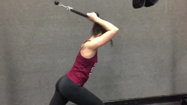 Female Standing Low Pulley Overhead Tricep Extension (rope extension) demonstration